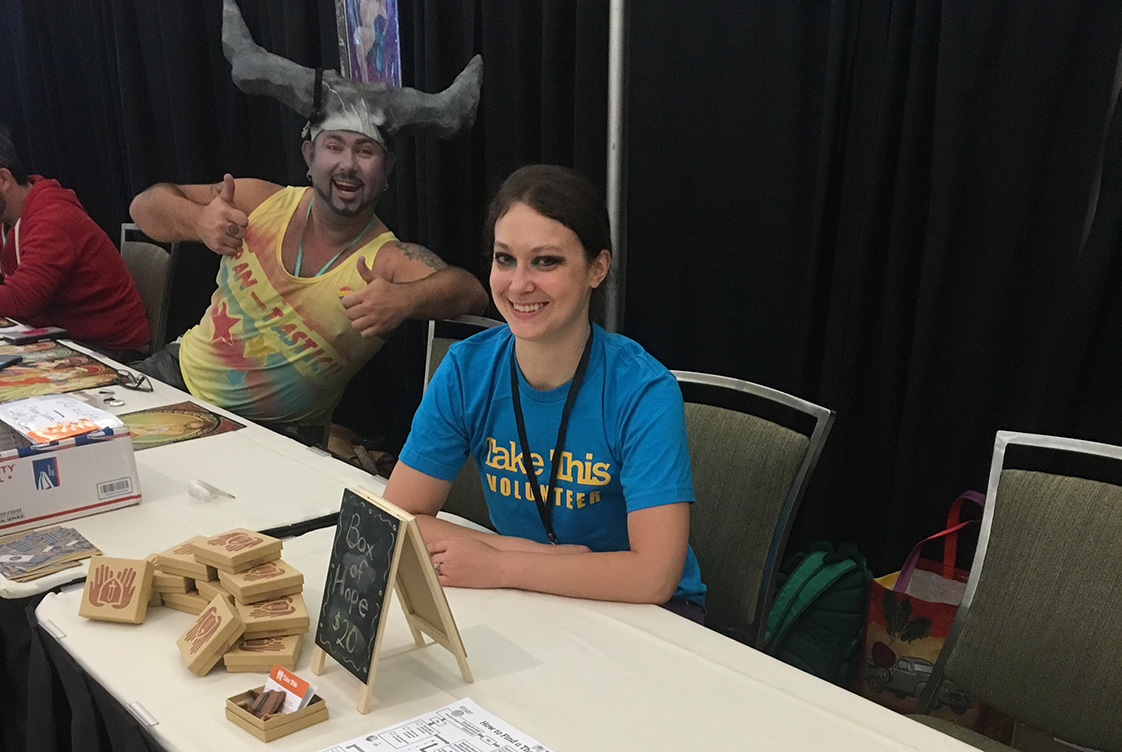 One of our smiling volunteers hanging out with the Iron Bull at PAX West