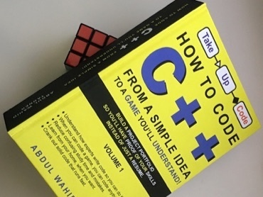 How To Code C++ From A Simple Idea To A Game You'll Understand shown with Rubik's Cube for scale