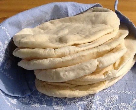 Homemade pitta breads are so easy to make and taste so much better than ready made. The pockets are perfect for all your favourite fillings or eaten with a tasty dip like hummus. Step by step instructions included.