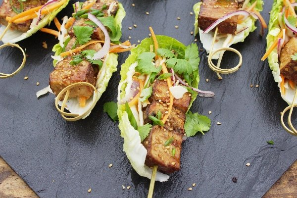 Sesame Tofu Kebabs are marinated in a delicious tahini dressing & served with a Tahini Asian Slaw. Serve in a lettuce wrap for a great vegan appetiser!