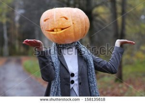 stock-photo-halloween-girl-with-pumpkin-head-158135618