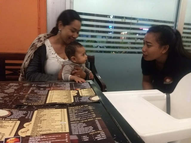In Bali restaurant with a baby already getting special attention