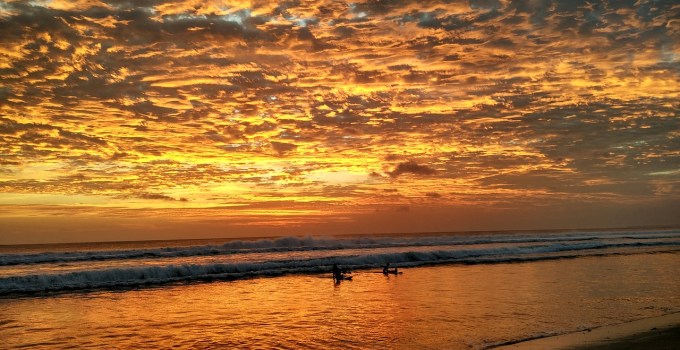 Bali Sunset with surfers enjoying the last natural light of the day