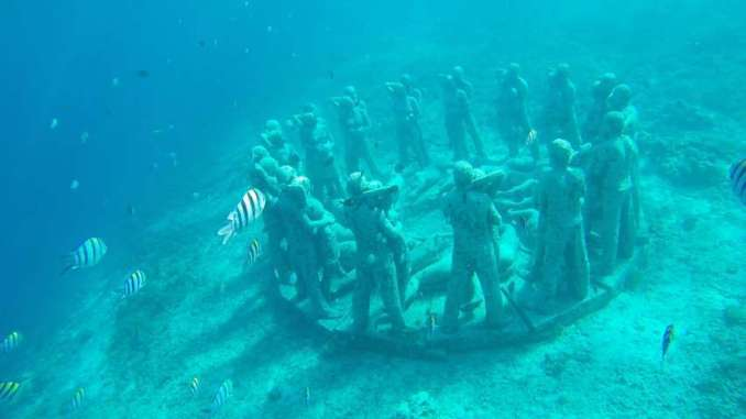 Statues at 3 meters depth when snorkeling at Gili Islands
