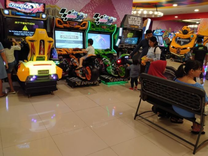 children playing games at arcade at trans studio mall