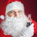 48726609 - santa claus holding cola fresh beverage at glass bottle. christmas holiday, new year. copy space for disign, text at red background