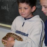 Student with snake