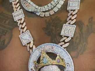 Davido gets himself new customized diamond necklace worth millions (Photos)