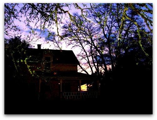 farmhouse, big trees, dark skies