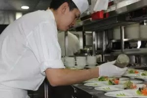 Chef Preparing Food for Dining Royal Albatross
