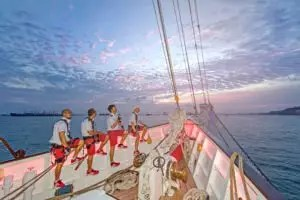 crew pictures on front deck in sunset royal albatross