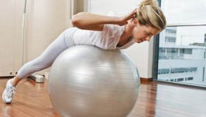 women-doing-abs-workout-with-exercise-ball
