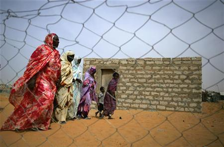 Mauritanians ex-slaves walk in a suburb outside Mauritania's capital Nouakchott, November 21, 2006. They do not wear chains, nor are they branded with the mark of their masters, but slaves still exist. CREDIT: REUTERS