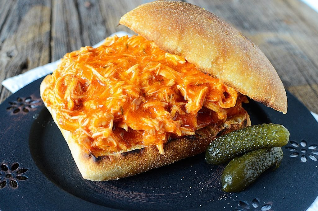 Simple Crock Pot Spicy Buffalo Ranch Chicken Sandwich Recipe! Only 3 ingredients needed to make this recipe. Perfect for Super Bowl or any day of the week. This easy slow cooker recipe is a family favorite!