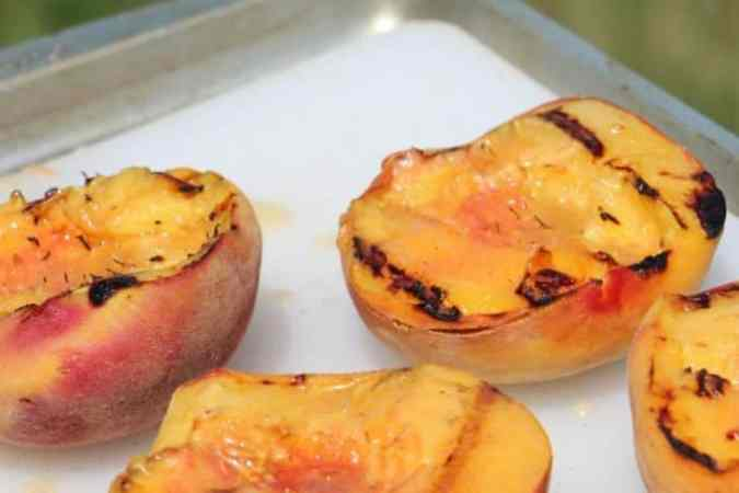Delicious Grilled Peaches with cinnamon sugar butter