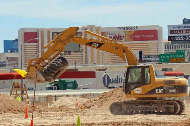 moving tires with excavator at Dig This Las Vegas