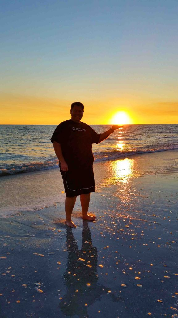 Blog John with the sun in his hand Sanibel Island Florida jpg