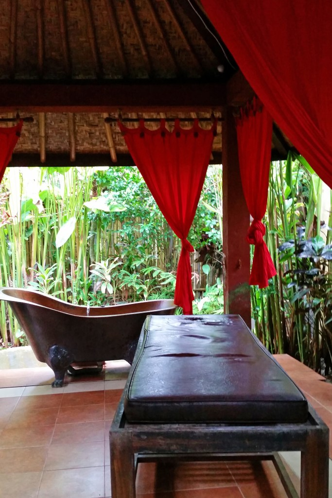Private outdoor massage room with copper tub Ubud Bali