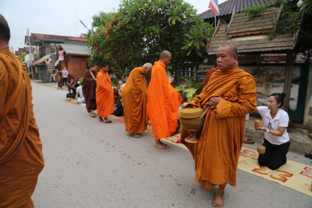 buddist monk northern Thailand gathering offerings