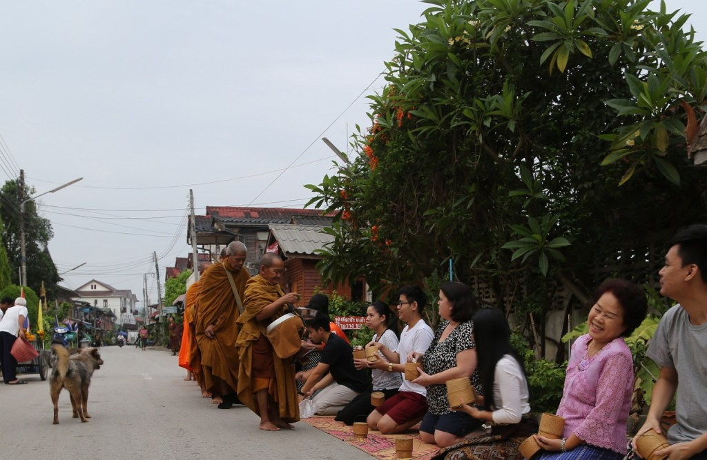 giving offerings to the monks in Northern Thailand