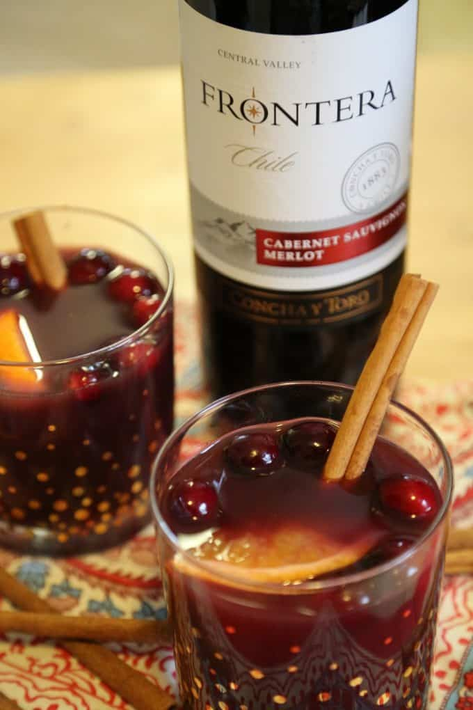 How to make Easy Crock Pot Hot Mulled Wine Recipe with cranberries! This slow cooker cocktail recipe is perfect for football parties or cold winter days!The crockpot does all the work! #crockpot #slowcooker #recipe #wine #cocktail #mulledwine #comfort