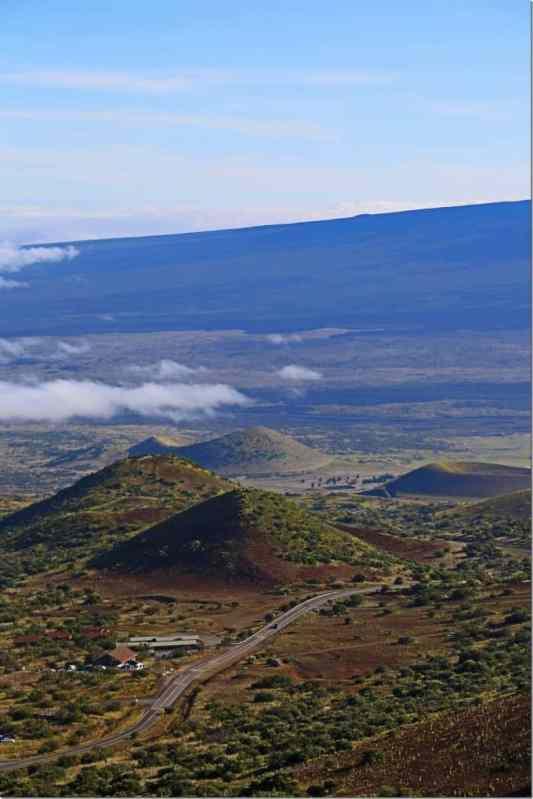 looking down to visitor center at 9000 feet elevation on Mauna Kea Big Island of Hawaii