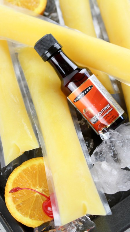 Fuzzy Navel Popsicle! Celebrate summer with these delicious adult boozy alcoholic fuzzy navel ice pops. homemade and so easy to make!