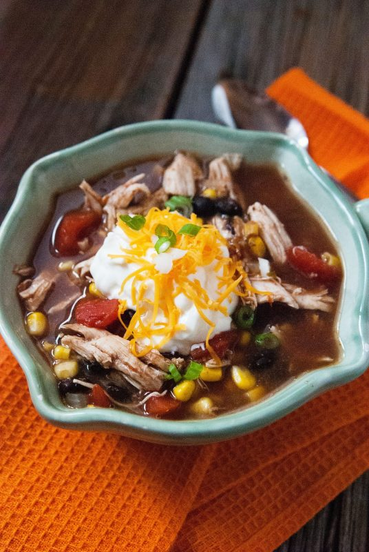 Easy Slow Cooker Crock Pot Chicken Enchilada Soup Recipe that is the perfect comfort food. #crockpot #slowcooker #soup #chicken