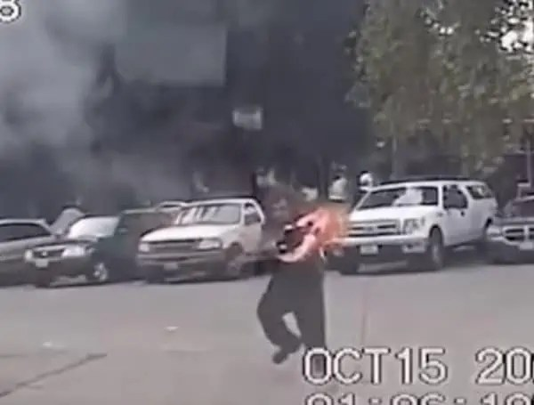 Seattle man catches police car on fire