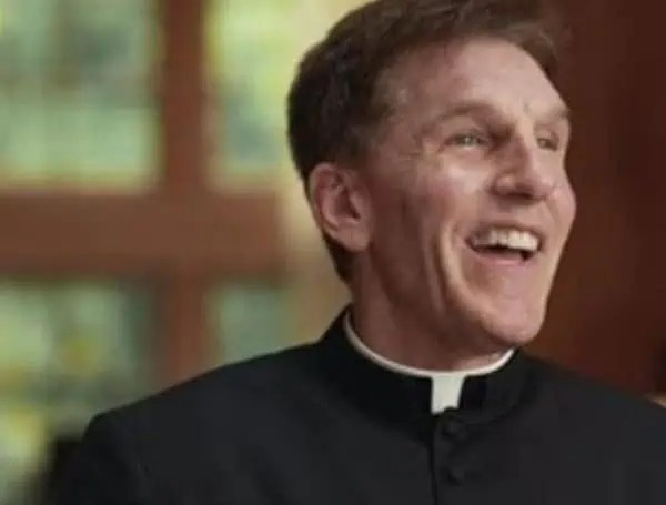priest removed from church