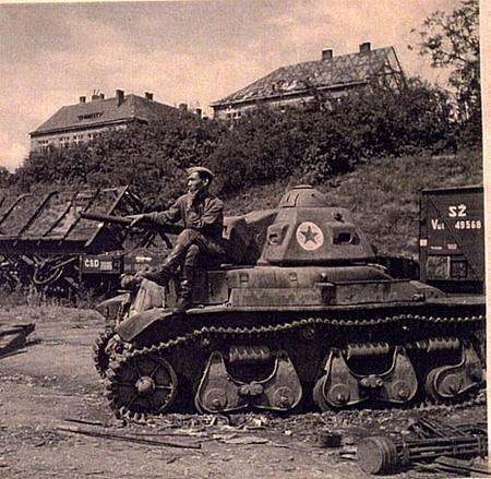 Similar photographs of the sameVânătorul de Care R35 with an unidentified Romanian or Soviet soldierin Znojmo Railway, 1945.
