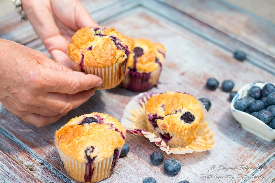Hands holding moist Blueberry Muffins