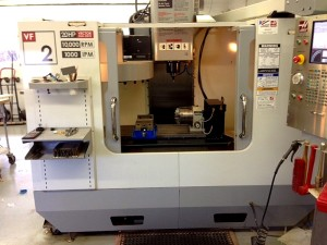 photo of bright clean machine on a job-shop floor Haas Model VF2 CNC Vertical Machining Center with Haas CNC Control
