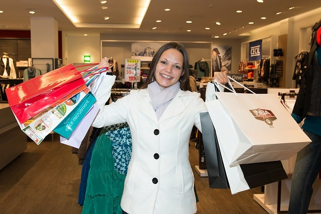 Happy Woman Shopper - pricing mistakes