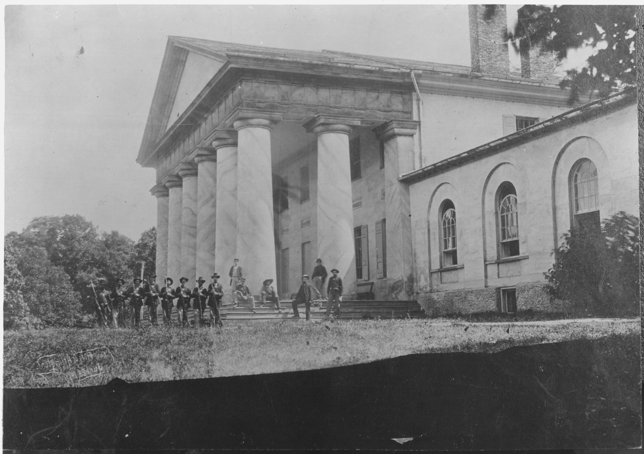 East_front_of_Arlington_Mansion_(General_Lee's_home),_with_Union_soldiers_on_the_lawn,_06-28-1864_-_NARA_-_533118