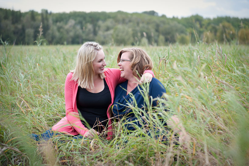 sisters in Fish Creek Park Calgary portrait photography captured by Tara Whittaker