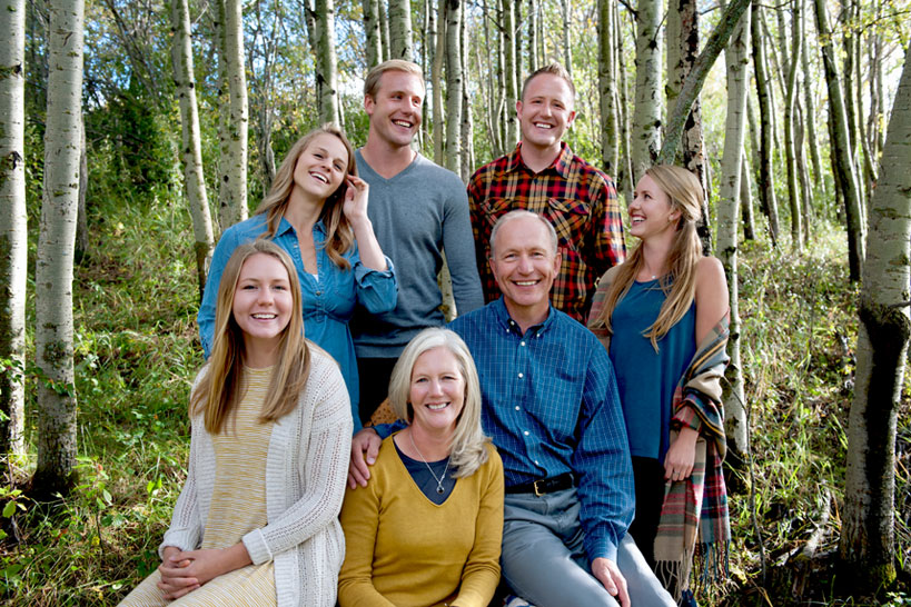 family laughing during their fall portrait session with Tara Whittaker Photography