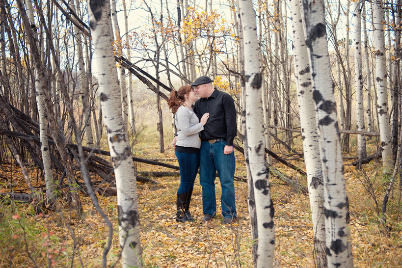 couple pose during their Fish Creek Park engagement session captured by Tara Whittaker Photography
