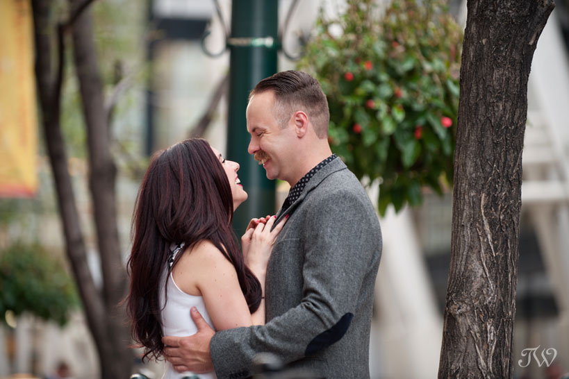 couple laugh during their engagement session captured by Tara Whittaker Photography