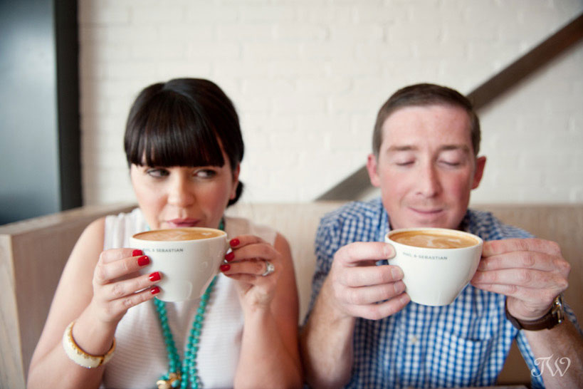 Couple sip coffee during their engagement session at Phil & Sebastian captured by Tara Whittaker Photography
