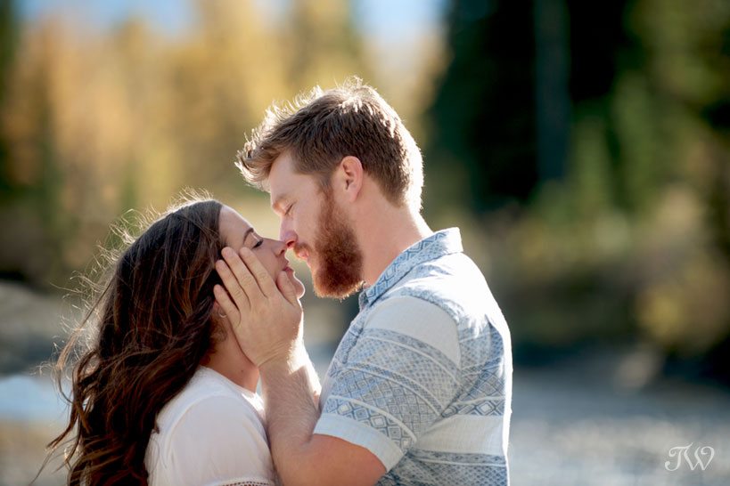 Sweet kiss during a fall engagement session captured by Tara Whittaker Photography