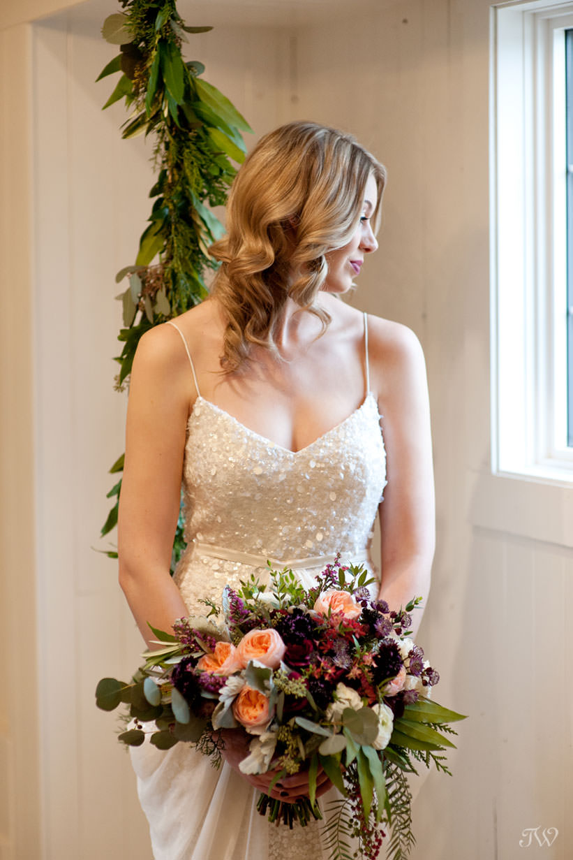 Bride carries a bouquet in berry tones from Flowers by Janie captured by Tara Whittaker Photography