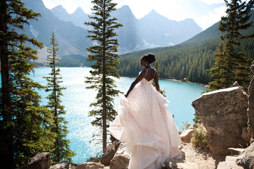Moraine Lake bride Debol on the lakeshore captured by Tara Whittaker Photography