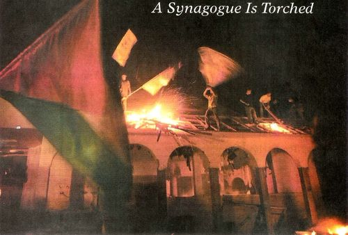 Palestinians destroying a Synagogue