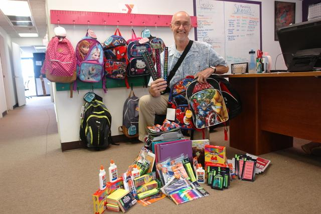 CEO, Pete with backpacks and school supplies