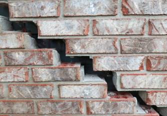 stairstep cracked brick before image