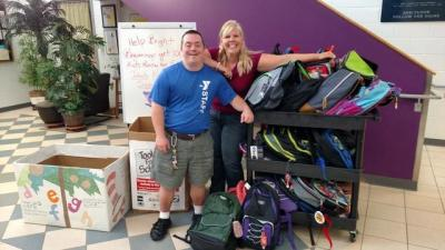 Team Tar Heel Donates Backpacks to Bryan YMCA