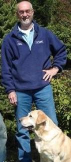 the owner, Pete Burgesswith his golden retriever