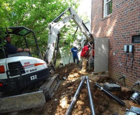 Brick Home in High Point, NC, Stabilized with 13 Helical Piers