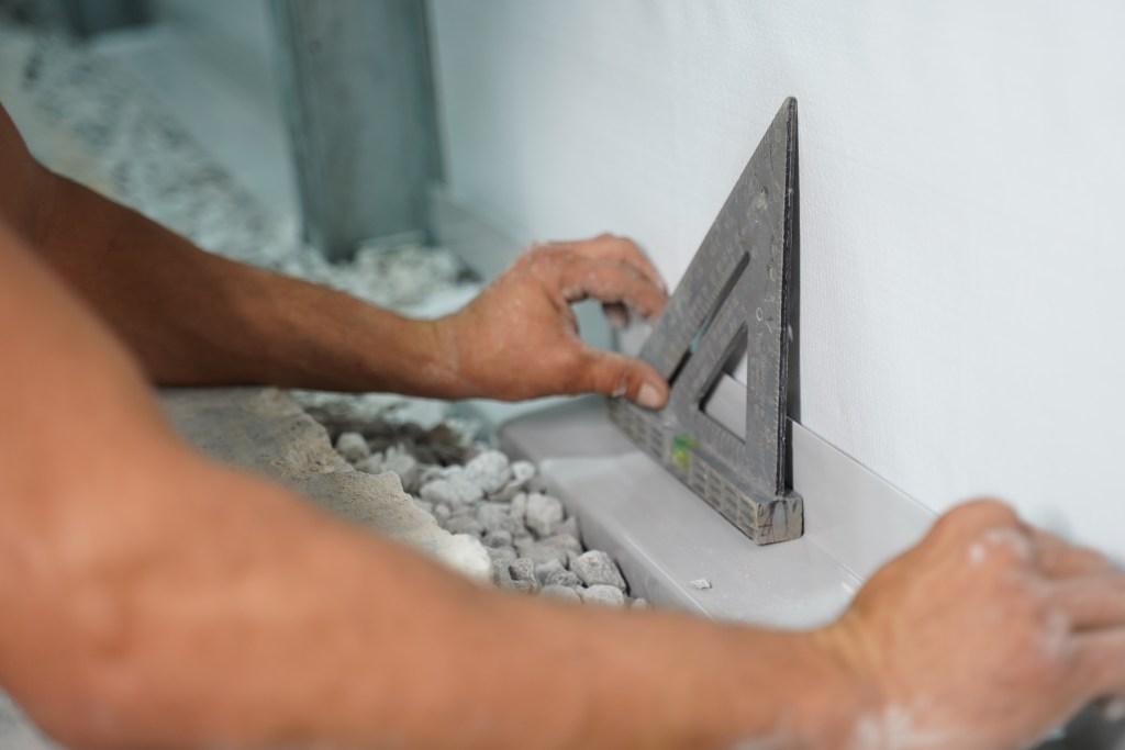 Basement Gutter Installation with Level